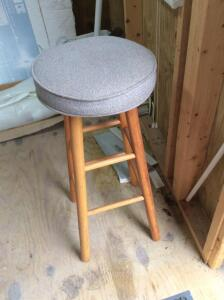 Wooden barstool with padded seat
