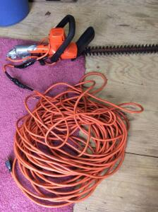 Electric hedge trimmer with extension cord