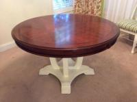 Round wooden pedestal dining table with leaf